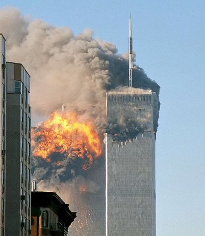 """""""North face south tower after plane strike 9-11"""" by Robert on Flickr - →This file has been extracted from another file: UA Flight 175 hits WTC south tower 9-11 edit.jpeg.. Licensed under CC BY-SA 2.0 via Commons - https://commons.wikimedia.org/wiki/File:North_face_south_tower_after_plane_strike_9-11.jpg#/media/File:North_face_south_tower_after_plane_strike_9-11.jpg"""