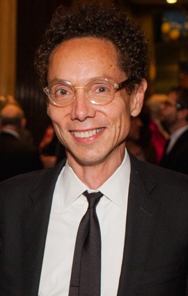"""Malcolm Gladwell 2014 (cropped)"" by PEN American Center - Philip Kerr and Malcolm Gladwell. Licensed under CC BY 2.0 via Commons - https://commons.wikimedia.org/wiki/File:Malcolm_Gladwell_2014_(cropped).jpg#/media/File:Malcolm_Gladwell_2014_(cropped).jpg"